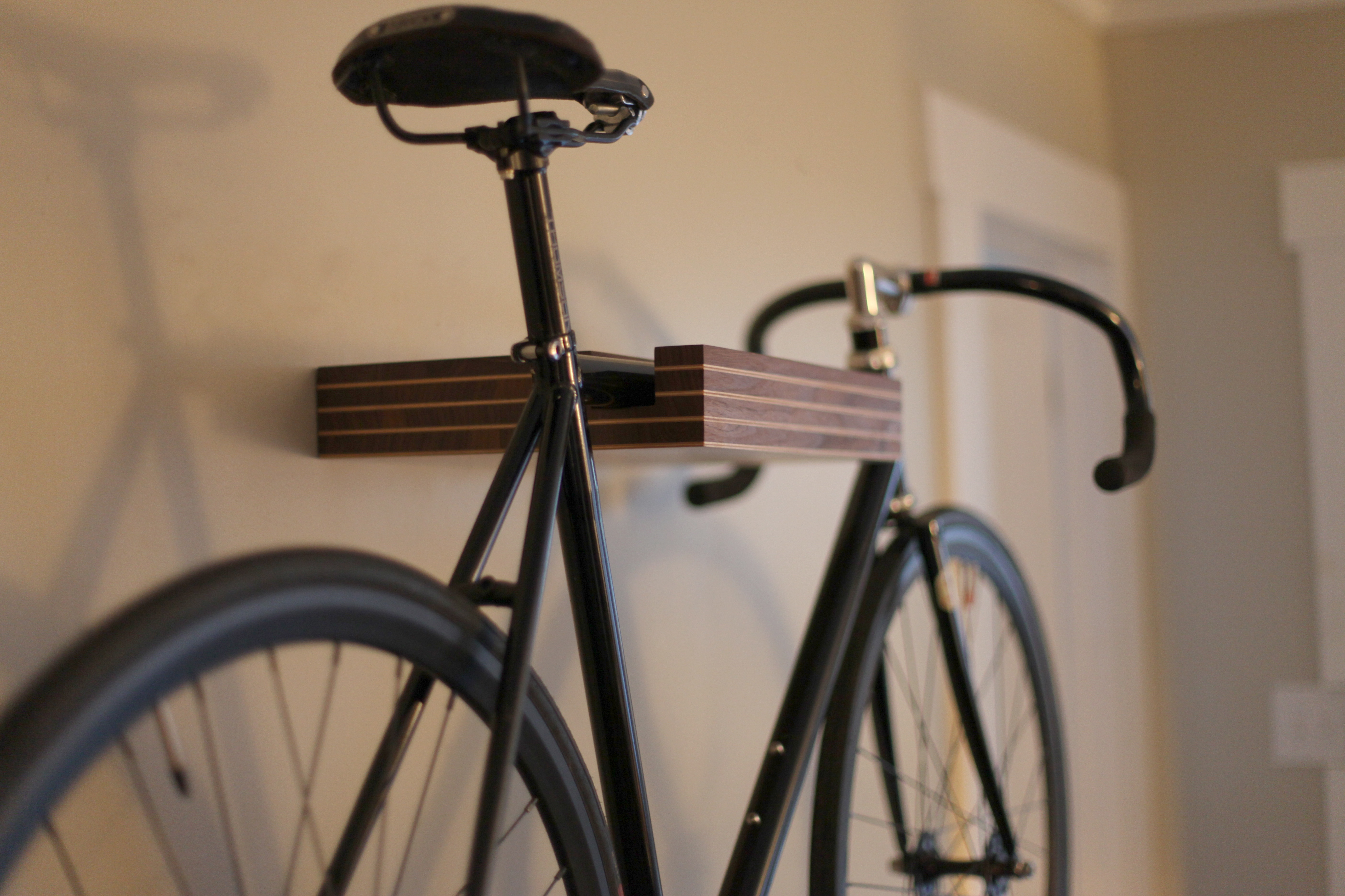 Look jeremy s bicycle rack apartment therapy - Pinstripe Bike Shelf The Pinstripe Bike Shelf Is Designed To Display Your Bike As A Piece Of Art While Still Looking Like A Simple Floating Shelf